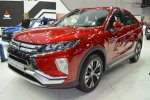 Mitsubishi-Eclipse-Cross-front-three-quarters-left-side-at-2017-Dubai-Motor-Show.jpg